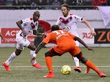 Bordeaux's Uruguyan forward Diego Rolan, Bordeaux's Czech midfielder Jaroslav Plasil and Lorient's Gabonese midielder Ndong Ibrahim Didier (C) play the ball during the French L1 football match between FC Lorient and FC Girondins de Bordeaux on May 2, 2015