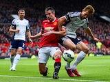 Robin van Persie of Manchester United tangles with Craig Dawson of West Brom during the Barclays Premier League match between Manchester United and West Bromwich Albion at Old Trafford on May 2, 2015