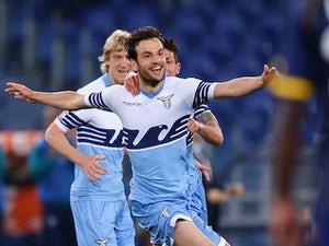 Lazio's Italian midfielder Marco Parolo (C) after scoring a goal during the Italian Serie A football match Lazio vs Parma on April 29, 2015