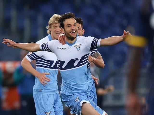 Lazio's Italian midfielder Marco Parolo (C) after scoring a goal during the Italian Serie A football match Lazio vs Parma on April 29, 2015