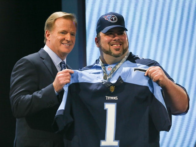 NFL Commissioner Roger Goodell holds up a jersey after the Tennessee Titans chose Marcus Mariota of the Oregon Ducks #2 overall during the first round of the 2015 NFL Draft at the Auditorium Theatre of Roosevelt University on April 30, 2015