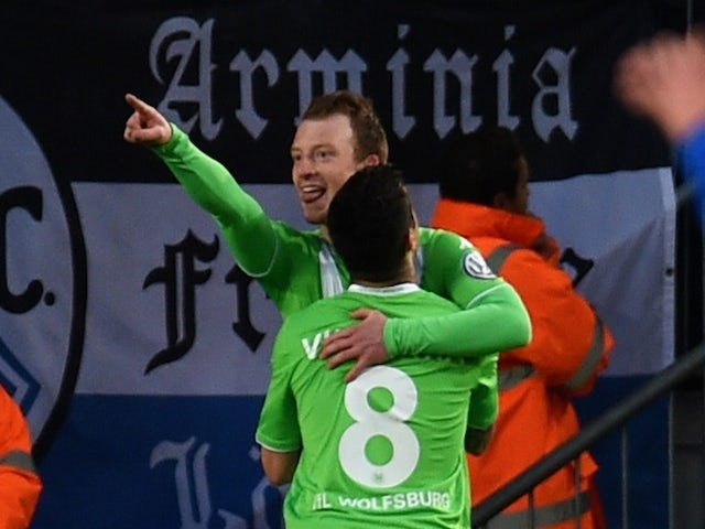 Wolfsburg's midfielder Maximilian Arnold and his teammate Portuguese striker Vieirinha (front) celebrate after scoring 0-1 during the German Cup DFB Pokal semi-final football match Bielefeld v Wolfsburg in Bielefeld, northern Germany, on April 29, 2015