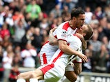 Carl Baker of MK Dons is congratulated by team mate Samir Carruthers after scoring his sides 1st goal during the Sky Bet League One match between MK Dons and Yeovil Town at Stadium mk on May 3, 2015