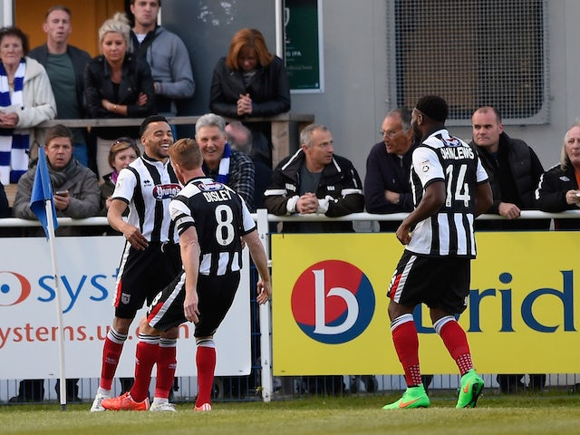 Nathan Arnold of Grimsby (L) celebrates with team mates after scoring during the Vanarama Football Conference League play off 1st leg match between Eastleigh FC and Grimsby Town at Silverlake Stadium on April 30, 2015