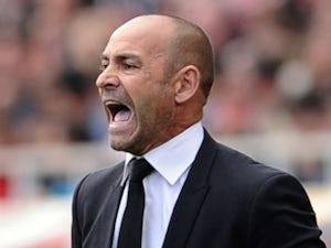 Rayo Vallecano's coach Paco Jemez reacts during the Spanish league football match Sevilla FC vs Rayo Vallecano de Madrid at the Ramon Sanchez Pizjuan stadium in Sevilla on April 26, 2015
