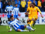 Daniel Johnson of Preston North End battles for the ball with Matt Briggs of Colchester United during the Sky Bet League One match between Colchester United and Preston North End at Colchester Community Stadium on May 3, 2015