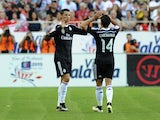 Real Madrid's Portuguese forward Cristiano Ronaldo celebrates with Real Madrid's Mexican forward Chicharito after scoring during the Spanish league football match Sevilla FC vs Real Madrid CF at the Ramon Sanchez Pizjuan stadium in Sevilla on May 2, 2015