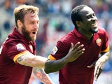 Roma's Ivorian midfielder Seydou Doumbia celebrates with Roma's forward Daniele De Rossi after scoring a goal during the Italian Serie A football match between AS Roma and Genoa on May 3, 2015