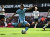 Sergio Aguero of Manchester City scores the opening goal during the Barclays Premier League match between Tottenham Hotspur and Manchester City at White Hart Lane on May 3, 2015