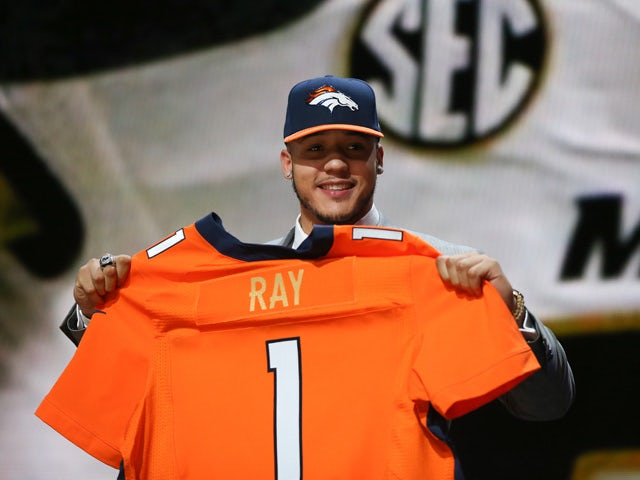 Shane Ray of the Missouri Tigers holds up a jersey after being picked #23 overall by the Denver Broncos during the first round of the 2015 NFL Draft at the Auditorium Theatre of Roosevelt University on April 30, 2015
