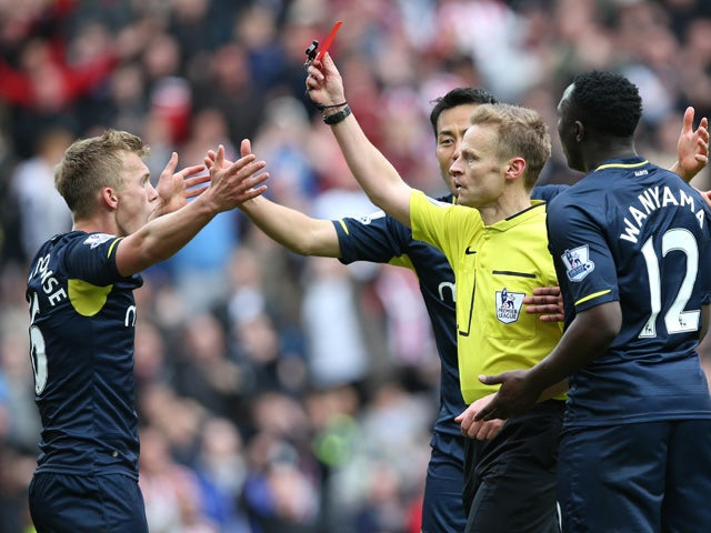 Southampton's English midfielder James Ward-Prowse (L) is given a red card during the English Premier League football match between Sunderland and Southampton at the Stadium of Light in Sunderland, northeast England, on May 2, 2015