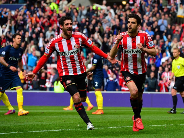 Jordi Gomez of Sunderland celebrates scoring his penalty with Danny Graham during the Barclays Premier League match between Sunderland and Southampton at Stadium of Light on May 2, 2015