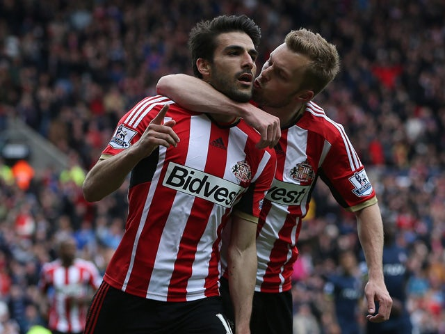 Sunderland's Jordi Gomez celebrates scoring his second penalty during the English Premier League football match between Sunderland and Southampton at the Stadium of Light in Sunderland, northeast England, on May 2, 2015