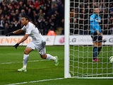 Jefferson Montero of Swansea City celebrates scoring his team's first goal during the Barclays Premier League match between Swansea City and Stoke City at Liberty Stadium on May 2, 2015