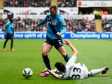 Phillip Bardsley of Stoke City and Federico Fernandez of Swansea City compete for the ball during the Barclays Premier League match between Swansea City and Stoke City at Liberty Stadium on May 2, 2015
