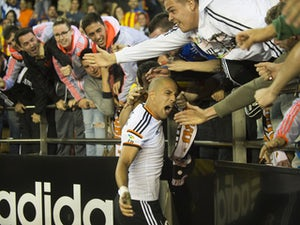 Valencia ease past Granada