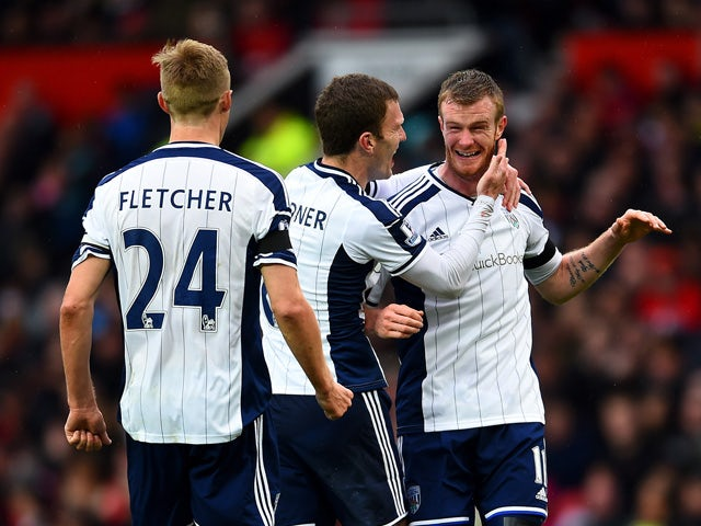 Chris Brunt of West Brom celebrates with team-mates Craig Gardner and Darren Fletcher after taking a free-kick which was deflected off Jonas Olsson of West Brom to score the opening goal during the Barclays Premier League match between Manchester United a