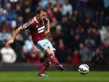 Mark Noble of West Ham United scores his team's first goal from the penalty spot during the Barclays Premier League match between West Ham United and Burnley at the Boleyn Ground on May 2, 2015
