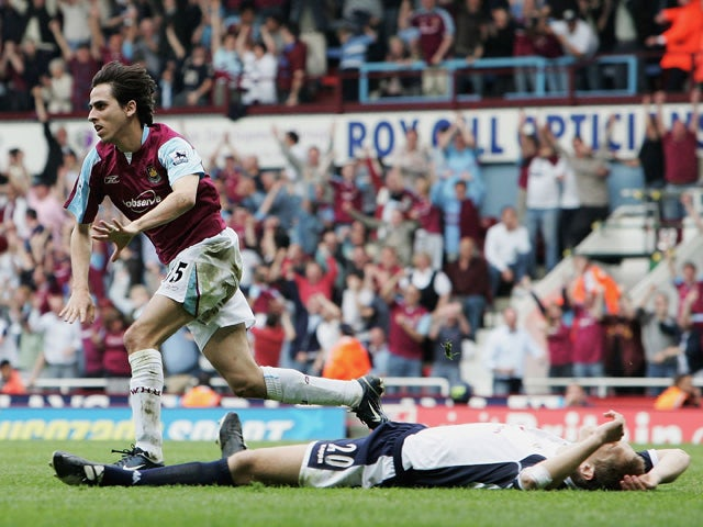Yossi Benayoun of West Ham United celebrates scoring their second goal as Michael Dawson of Tottenham Hotspur lays on the pitch during the Barclays Premiership match between West Ham United and Tottenham Hotspur at Upton Park on May 7, 2006