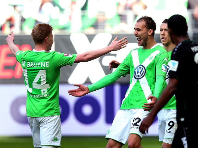 Wolfsburg's Dutch striker Bas Dost celebrates after scoring his team's opening goal during the German first division Bundesliga football match between VfL Wolfsburg and Hannover 96 at the Volkswagen Arena in Wolfsburg, central Germany, on May 2, 2015