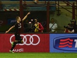 AC Milan's Dutch midfielder Marco Van Ginkel celebrates after scoring during the Serie A football match between AC Milan and AS Roma at San Siro Stadium in Milan on May 9, 2015