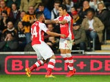 Alexis Sanchez of Arsenal (R) celebrates with Francis Coquelin as he scores their first goal during the Barclays Premier League match between Hull City and Arsenal at KC Stadium on May 4, 2015