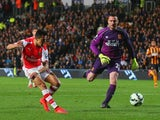 Alexis Sanchez of Arsenal (17) beats goalkeeper Steve Harper of Hull City as he scores their third goal during the Barclays Premier League match between Hull City and Arsenal at KC Stadium on May 4, 2015
