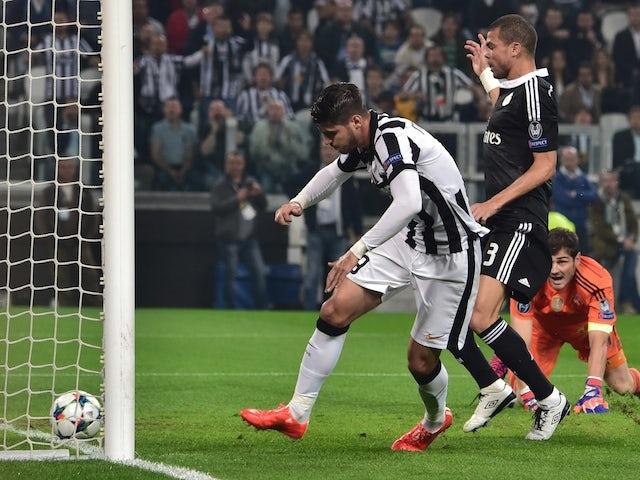Juventus' forward from Spain Alvaro Morata scores during the UEFA Champions League semi-final first leg football match Juventus vs Real Madrid on May 5, 2015