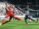Ayoze Perez of Newcastle United scores during the Barclays Premier League match between Newcastle United and West Bromwich Albion at St James' Park on May 9, 2015