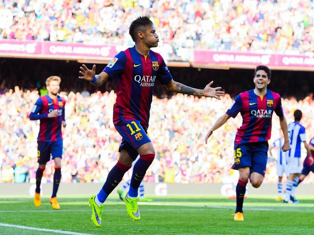 Neymar of FC Barcelona celebrates after scoring the opening goal during the La Liga match between FC Barcelona and Real Sociedad de Futbol at Camp Nou on May 9, 2015