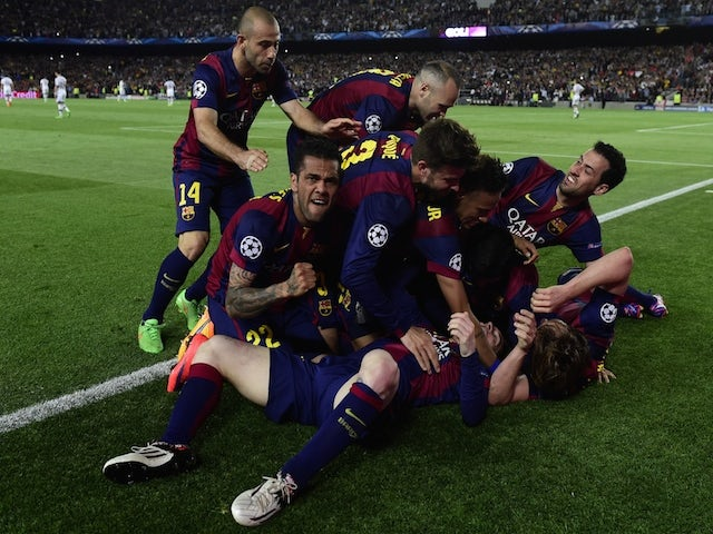 Barcelona players celebrate a goal during the UEFA Champions League football match FC Barcelona vs FC Bayern Muenchen at the Camp Nou stadium in Barcelona on May 6, 2015