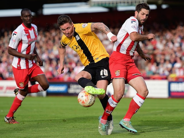 Barry Corr of Southend United battles with Dean Wells of Stevenage during the Sky Bet League 2 Playoff Semi-Final between Stevenage and Southend United at The Lamex Stadium on May 10, 2015