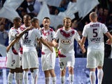 Bordeaux's players celebrate after scoring a goal during the French L1 football match between Bordeaux and Nantes on may 9, 2015