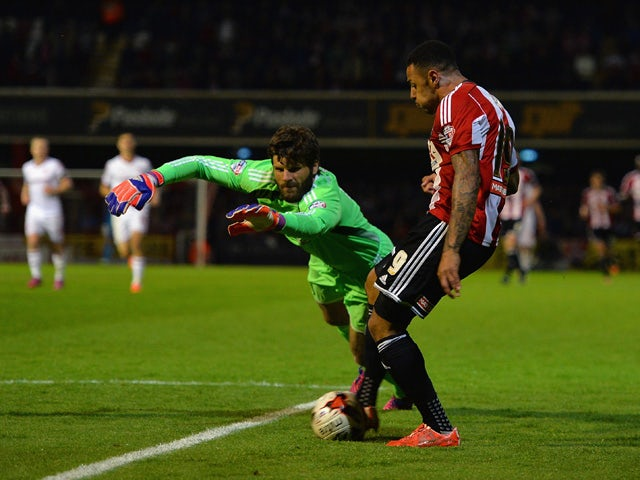Andre Gray of Brentford scores their first goal during the Sky Bet Championship Playoff Semi-Final between Brentford and Middlesbrough at Griffin Park on May 8, 2015