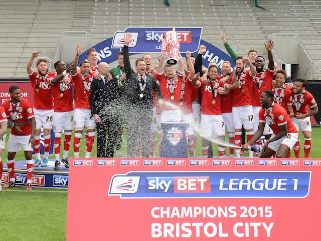 Bristol City players celebrate their League One championship win on May 4, 2015