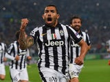 Carlos Tevez of Juventus celebrates as he scores their second goal from a penalty during the UEFA Champions League semi final first leg match between Juventus and Real Madrid CF at Juventus Arena on May 5, 2015