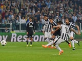 Carlos Tevez of Juventus scores their second goal from a penalty during the UEFA Champions League semi final first leg match between Juventus and Real Madrid CF at Juventus Arena on May 5, 2015