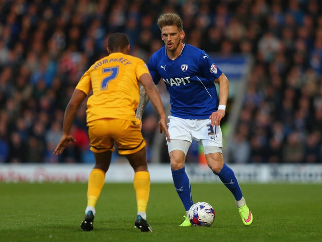 Daniel Jones of Chesterfield takes on Chris Humphrey of Preston North End during the Sky Bet League One Playoff Semi-Final, first leg match between Chesterfield and Preston North End at the Proact Stadium on May 7, 2015