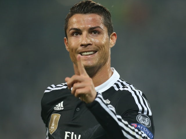 Real Madrid's Portuguese forward Cristiano Ronaldo celebrates after scoring during the UEFA Champions League semi-final first leg football match Juventus vs Real Madrid on May 5, 2015