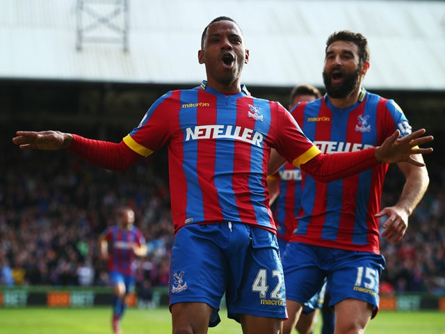 Jason Puncheon of Crystal Palace celebrates his team's first goal with Mile Jedinak during the Barclays Premier League match between Crystal Palace and Manchester United at Selhurst Park on May 9, 2015