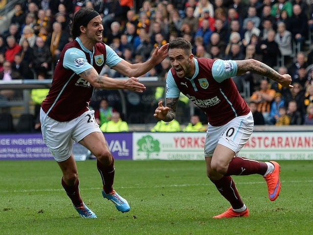 Burnley's English striker Danny Ings (R) celebrates scoring his goal with team mate Burnley's Scottish midfielder George Boyd during the English Premier League football match between Hull City and Burnley at the KC Stadium in Kingston upon Hull, north eas