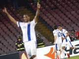 Dnipro's players celebrate after scoring during the UEFA Europa League semi final first leg football match SSC Napoli vs FK Dnipro Dnipropetrovsk on May 7, 2015