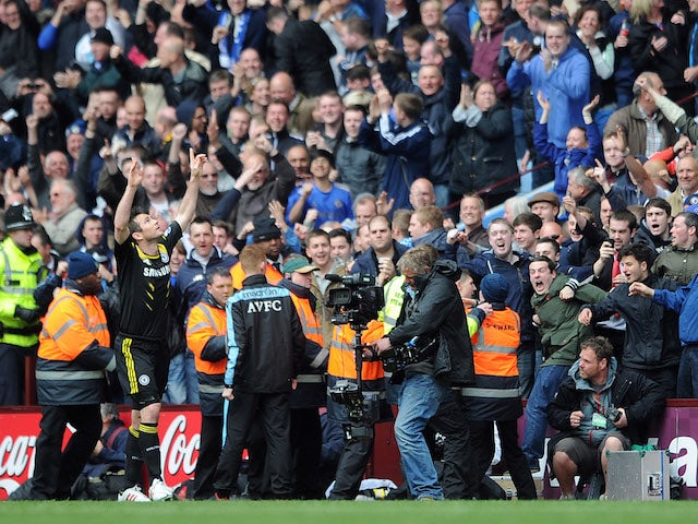 Chelsea's Frank Lampard celebrates his record breaking goal against Aston Villa on May 13, 2013