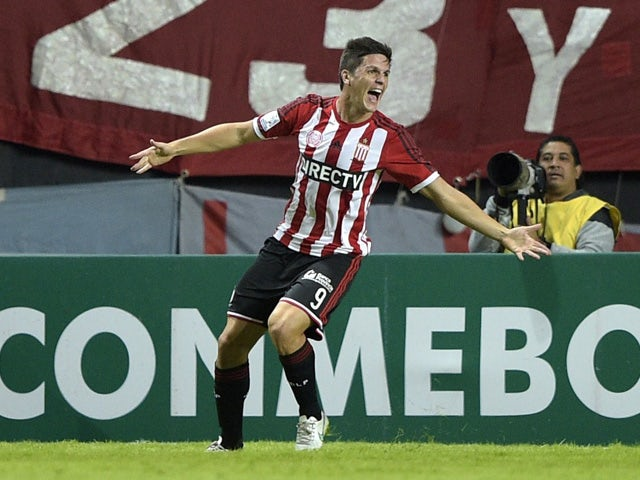 Argentina's Estudiantes de La Plata's forward Guido Carrillo celebrates after scoring the team's second goal against Colombia's Independiente Santa Fe during the Copa Libertadores 2015 round before the quarterfinals first leg football match at Ciudad de L