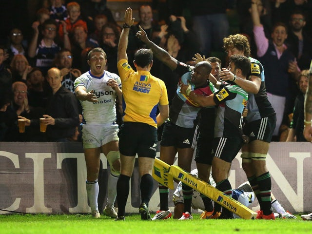 Ugo Monye of Harlequins is mobbed by team mates after scoring his second try during the Aviva Premiership match between Harlequins and Bath at the Twickenham Stoop on May 8, 2015