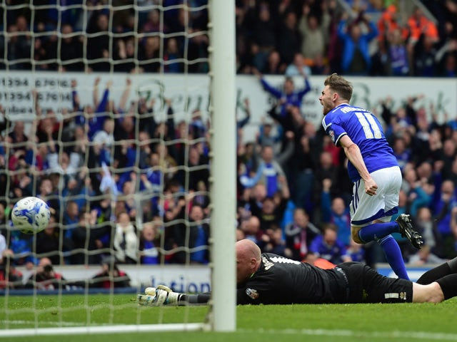 Paul Anderson of Ipswich scores past John Ruddy of Norwich during the Sky Bet Championship Playoff semi-final first leg match between Ipswich Town and Norwich Cityat Portman Road on May 9, 2015