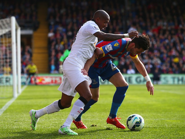 Joel Ward of Crystal Palace is challenged by Ashley Young of Manchester United during the Barclays Premier League match between Crystal Palace and Manchester United at Selhurst Park on May 9, 2015