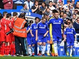 Captain John Terry of Chelsea leads out his team through a guard of honour by the Liverpool players during the Barclays Premier League match between Chelsea and Liverpool at Stamford Bridge on May 10, 2015
