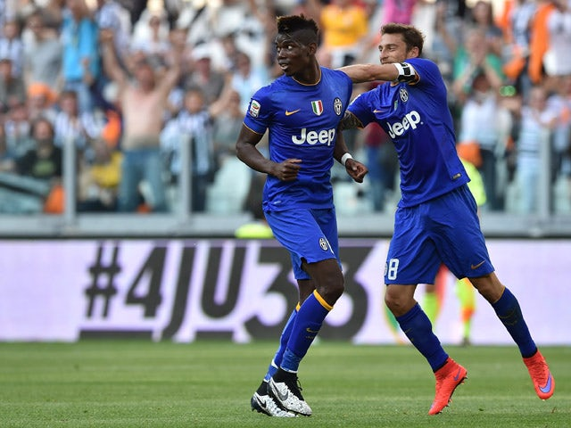 Paul Pogba of Juventus FC celebrates the opening goal with team mate Claudio Marchisio during the Serie A match between Juventus FC and Cagliari Calcio at Juventus Arena on May 09, 2015