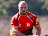 Lachlan McCaffrey of London Welsh runs with the ball during the Aviva Premiership match between London Welsh and Exeter Chiefs at the Kassam Stadium on September 7, 2014